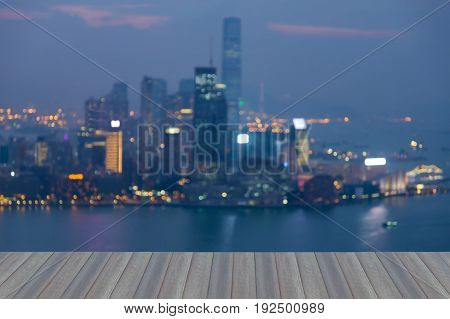 Opening wooden floor Hong Kong night blurred bokeh light over Victoria bay abstract background