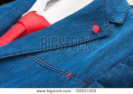 Close-up of denim suit and red tie. Fashion and Style