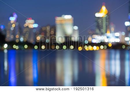 Abstract blurred bokeh city downtown light with reflection at twilight abstract background