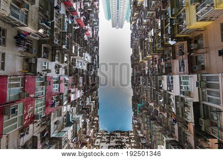 Hong Kong crowded residence apartment downtown bottom view cityscape background