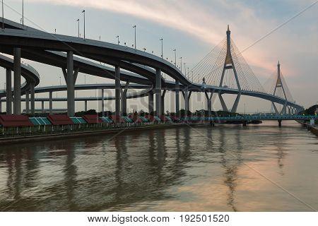 Double suspension bridge crossing Bangkok city river Bangkok Thailand