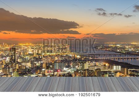 Opening wooden floor Beauty Osaka city skyline after sunset sky background Japan