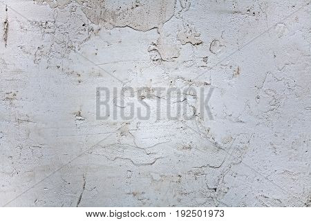 Texture from the plastered wall. A background from cement plaster. Cement mortar on the wall.