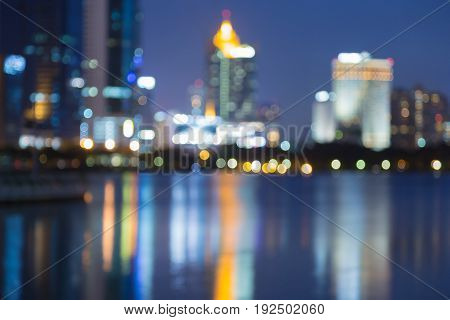 Night city blurred bokeh light downtown with reflection abstract background