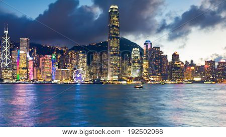 Hong Kong business downtown blurred bokeh light seafront abstract background