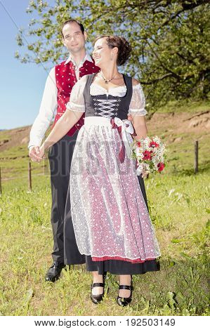 A lovely couple with traditional bavarian tracht