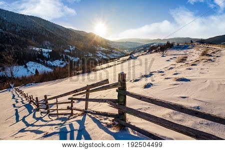 Wooden Fence By In Winter Rural Area