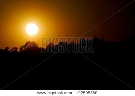Beautiful summertime sunset, perfect circle sunshine, radial, ombre, orange colors, bright sun