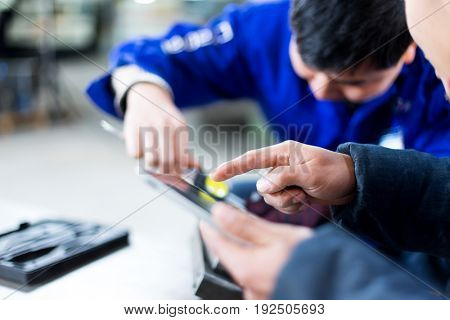 young technicians checking product in manufacturing factory