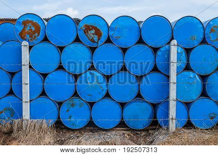 The blue oil gallons are putted in many rows