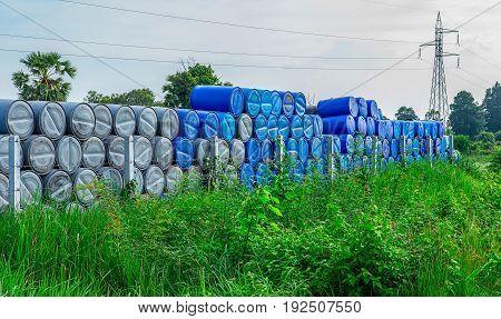 blue grey barrels on a pile Chemical Plant Plastic Storage Drums