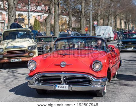 NORRKOPING, SWEDEN - MAY 1, 2017: Oldsmobile 88, 1956, cabriolet at vintage car parade in Norrkoping. This parade started in 1974 and has become an annual tradition on May Day.