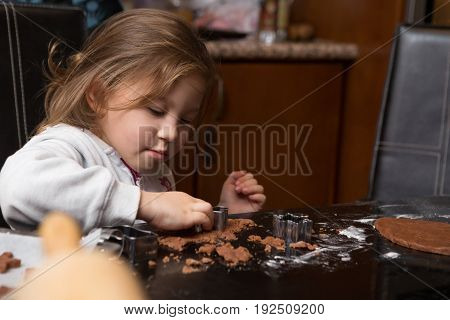 Little Girl Learning to Bake at Home