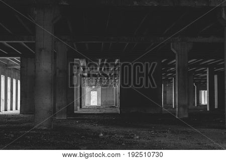 Old abandoned building. Dark image. Abandoned place. Building concrete skeleton. Black and white.