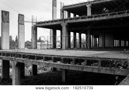 Abandoned construction site building. Abandoned place. Building skeleton. Black and white.