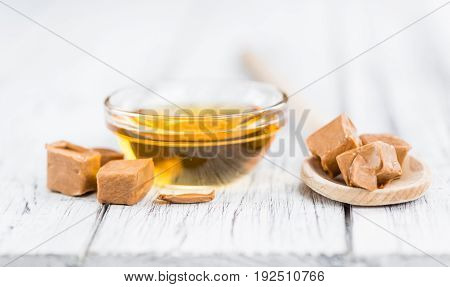 Caramel Syrup On Wooden Background (selective Focus)