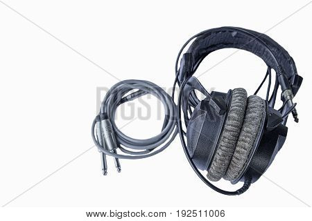Black retro headphones on white isolated background