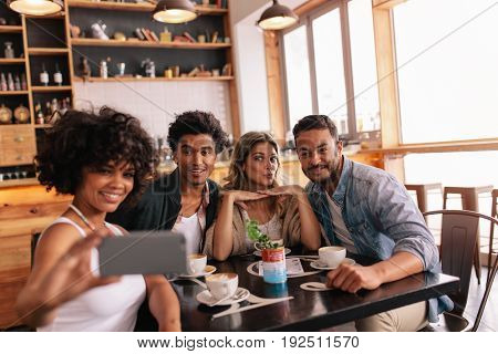 Small Group Of Friends Taking Selfie At Cafe