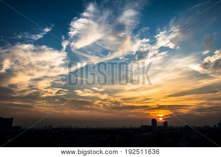 The beautiful sky and sunset with cityscape silhouette.