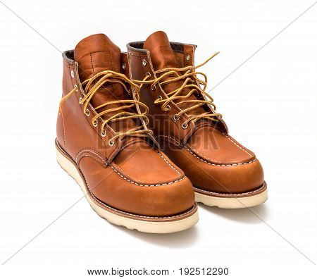 American brown working boots on a white background