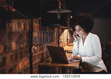 Happy Businesswoman Working Late In Office