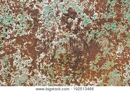 Grunge styled rusty old green and brown iron wall backgrounds of outdoor textured old damaged steel wall
