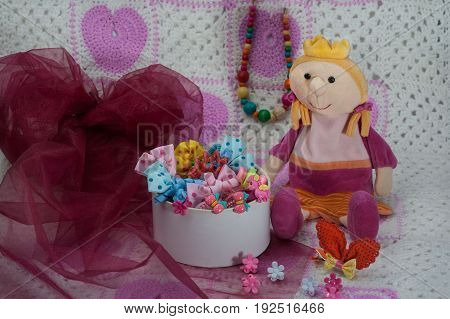 Different colored gums pins beads bows for girls. Beauty salon for a little princess