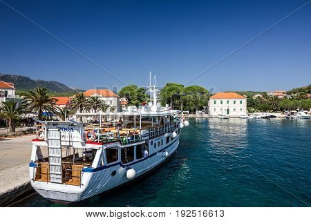 Hvar island, Croatia - May 7, 2017: Boat in port of Hvar island