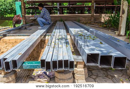 Rust steel beams iron bar on house construction site outdoor. Steel trusses for roofing