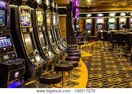 Cruise liner Voyager - May 12, 2017: Gaming slot machines gambling casino on cruise ship Voyager