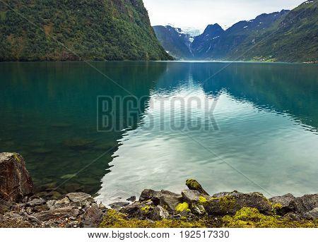 Oldenvatnet water Under Briksdal Glacier in Norway.