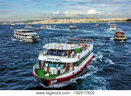 Istanbul, Turkey - May 7, 2017: Tourist vessels in Bosporus, Istanbul, Turkey