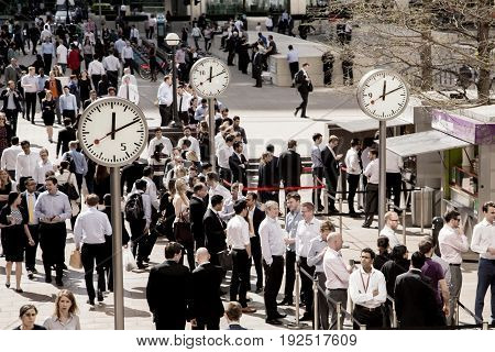 UK London - April 08 2015: Time for lunch for office workers in Canary Wharf. Business life of London