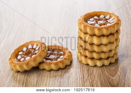 Stack Of Cookies With Jam On Table
