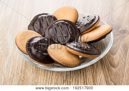 Chocolate Cookies With Stuffed In Transparent Saucer On Table