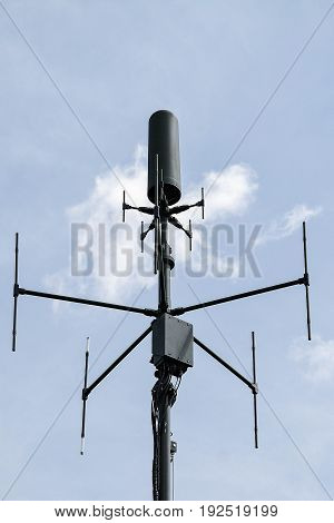 Military aerial of cellular communication on blue sky background