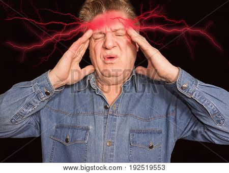 Senior man with headache. Concept of pain on black