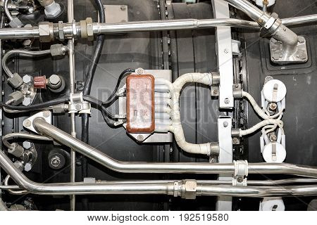 Engine's maintenance in huge industrial hall close up
