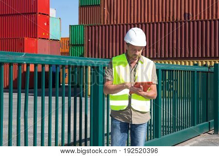 Supervisor Man With Helmet In Shipping Area