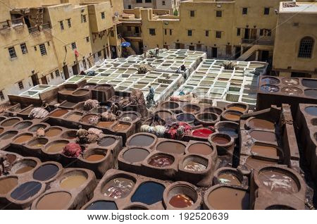 Fez, Morocco - May 9, 2017: Chouwara Leather traditional tannery in ancient medina of Fes El Bali Morocco Africa.