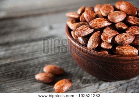 Roasted Almonds In Bowl On Wooden Table Selective Focus