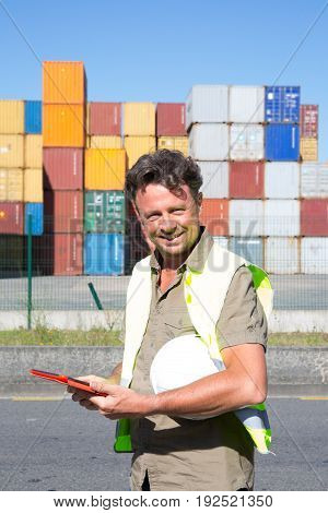 Working Man In Container Area In Logistic Zone Area