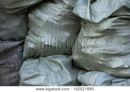 A pile of sacks with construction debris carrying out repairs