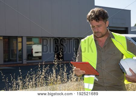 a shipping company man workers counting containers
