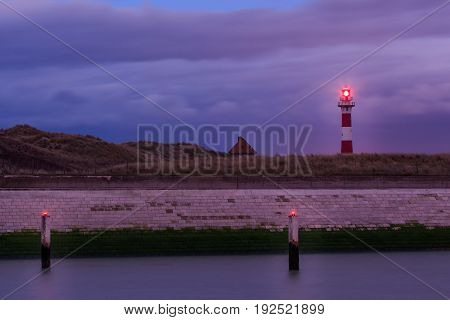 Red and white lighthouse in the evening. Nieuwpoort Flanders Belgium