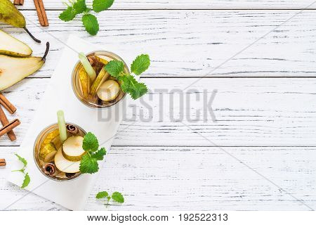 Drinks With Pear, Cinnamon. White Table. Copy Space, Top View