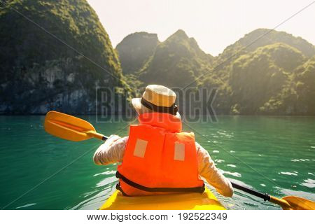 Tourist Kayaking In Halong Bay Seaside Of Vietnam