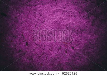 Magenta vintage background. Rough pink and magenta texture and background for designers. Close up view of abstract pink and magenta texture made with recycle paper. Plant fiber background.