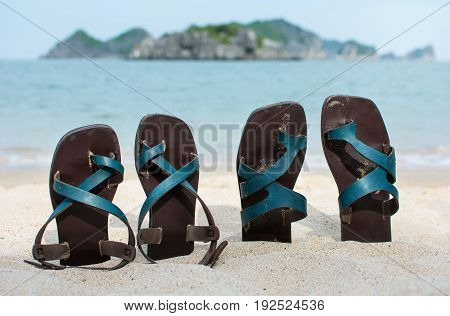 Male And Female Leather Slippers In The Sand