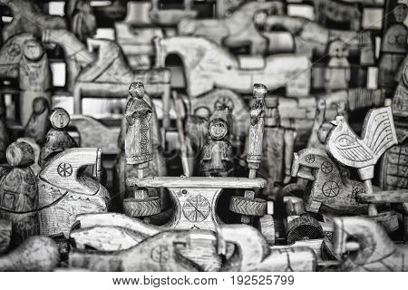 Wooden figures of people and animals with shallow depth of field